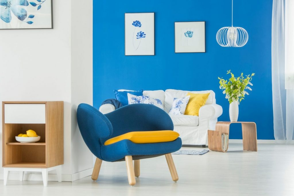 living area with blue accent wall