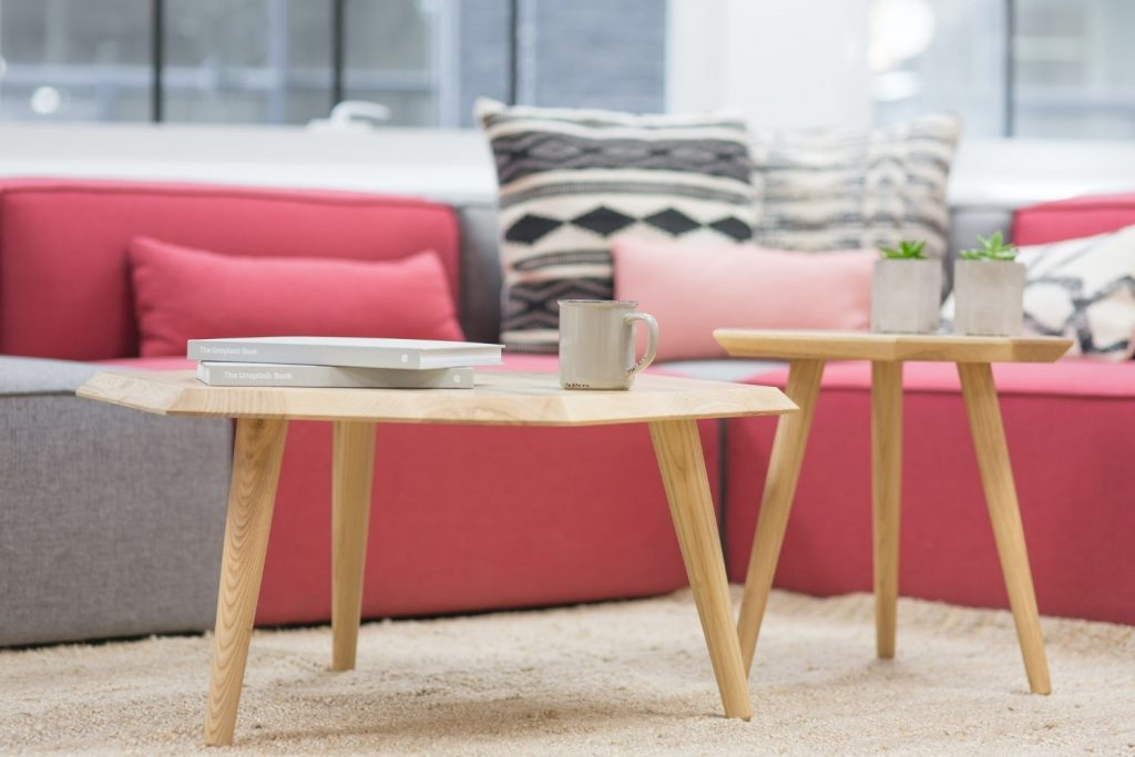 pink sofa with accent pillows and coffee table