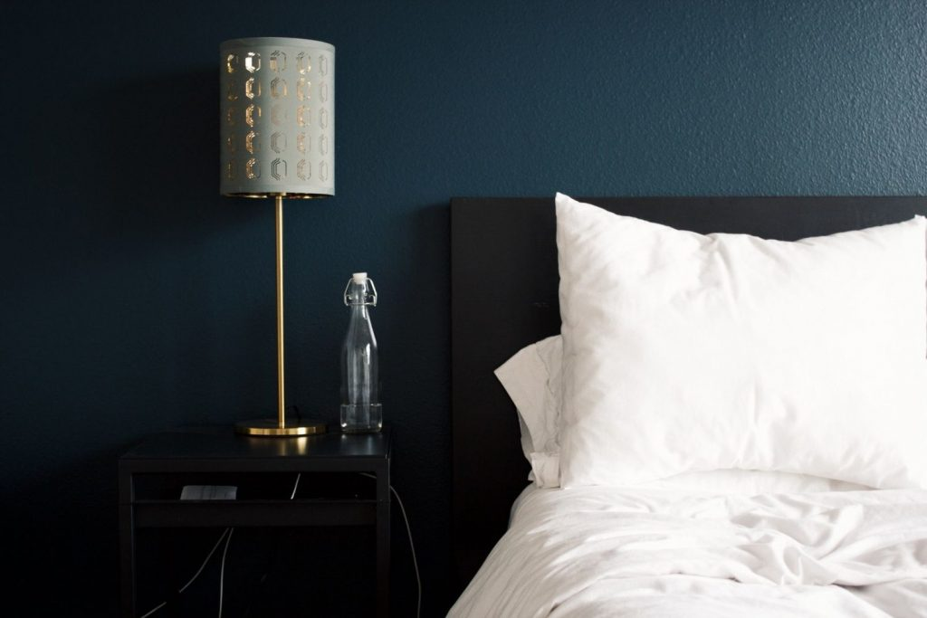 bedroom with navy blue wall
