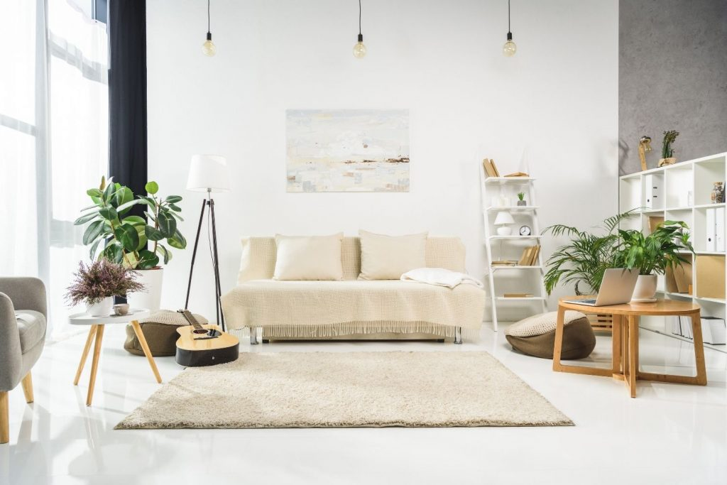 a living room that displays how to arrange wall art in living room