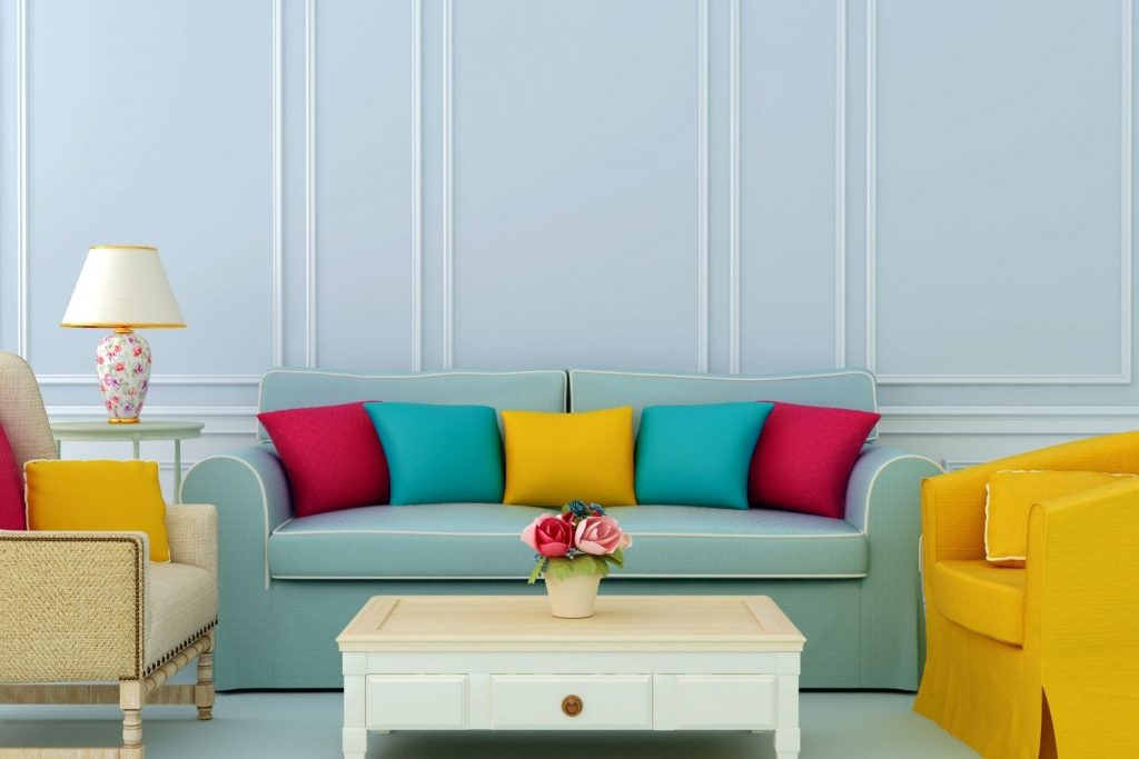 home interior with accent pillows in a triadic color scheme