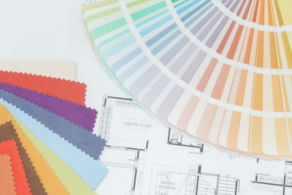 flatlay of paint color chips and home blueprint - the featured image for the article on 5 Great Options for a Whole House Color Palette from Benjamin Moore