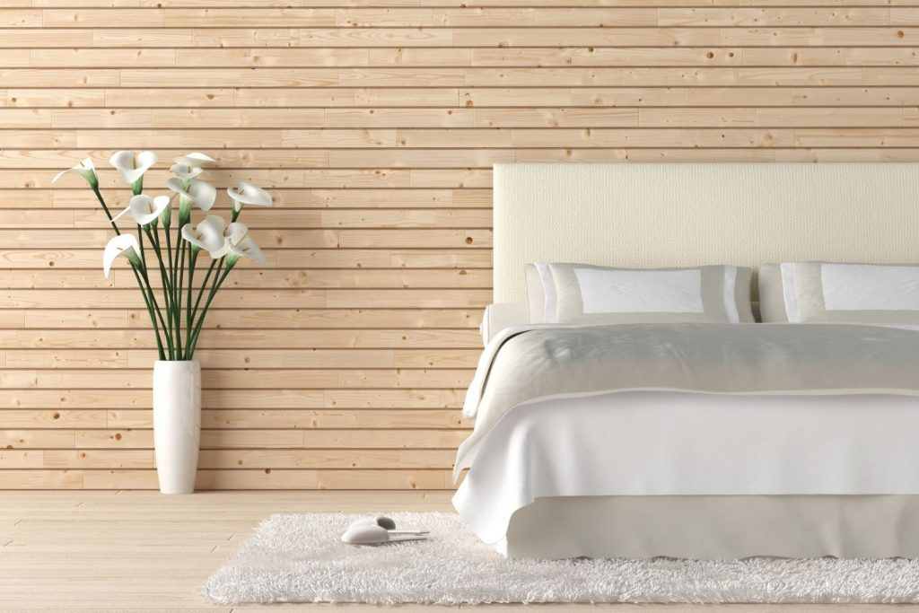textured feature wall with natural wood boards - just one awesome idea for decorating the wall behind your headboard