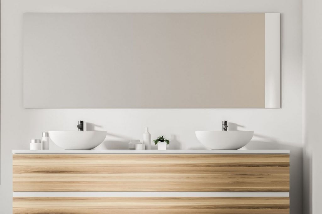 sink and vanity on white walls