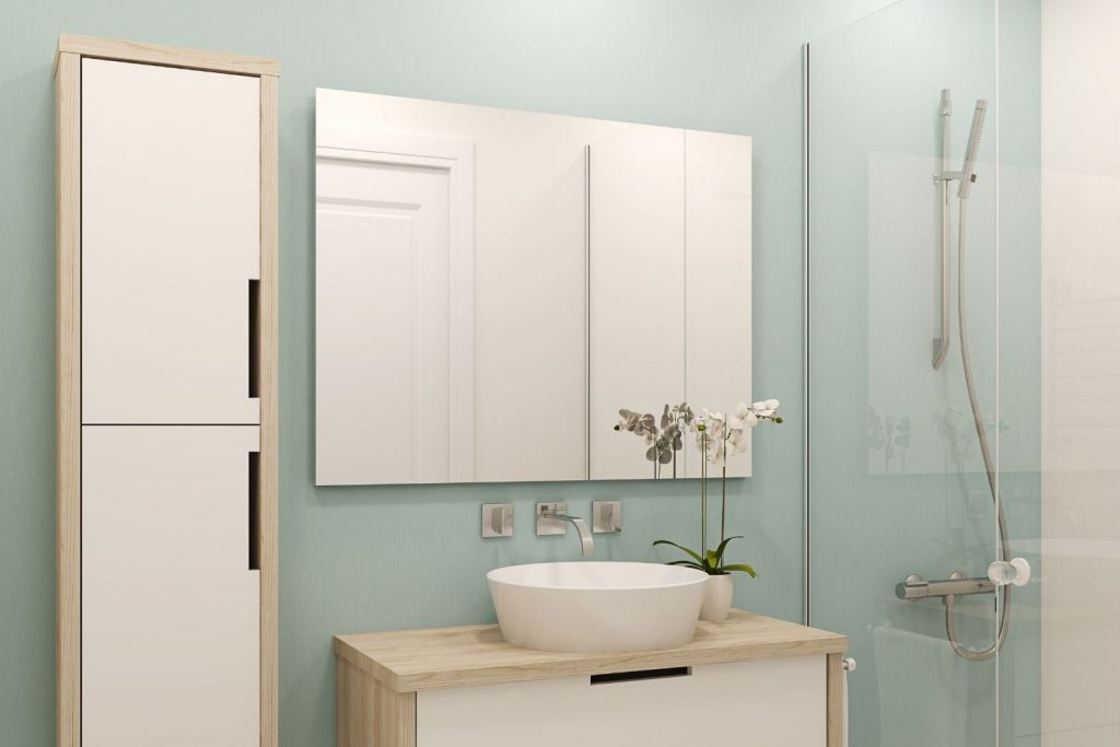 bathroom with blue-green walls - a great paint color for small bathroom with no windows