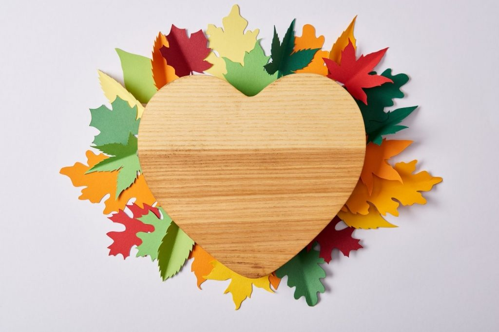 wood heart with paper leaves