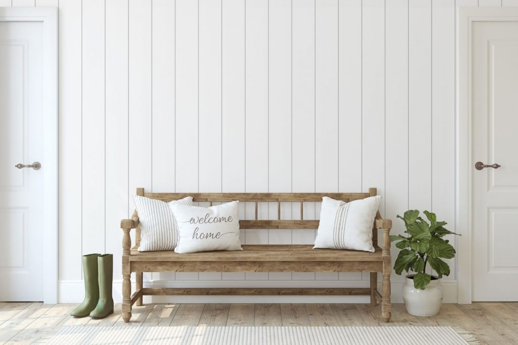 farmhouse style bench with white pillows - the featured image for the article on benjamin moore farmhouse paint colors