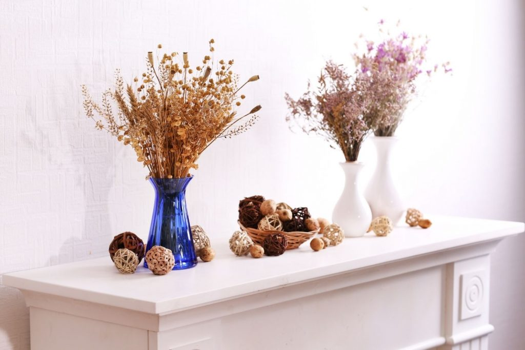 blue and white vases with thanksgiving decor on a white mantel